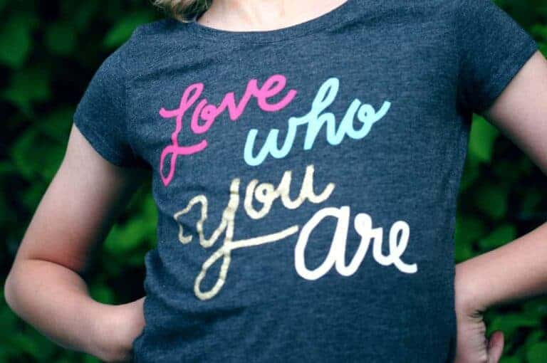 Proud person wears t-shirt that reads 'love who you are'