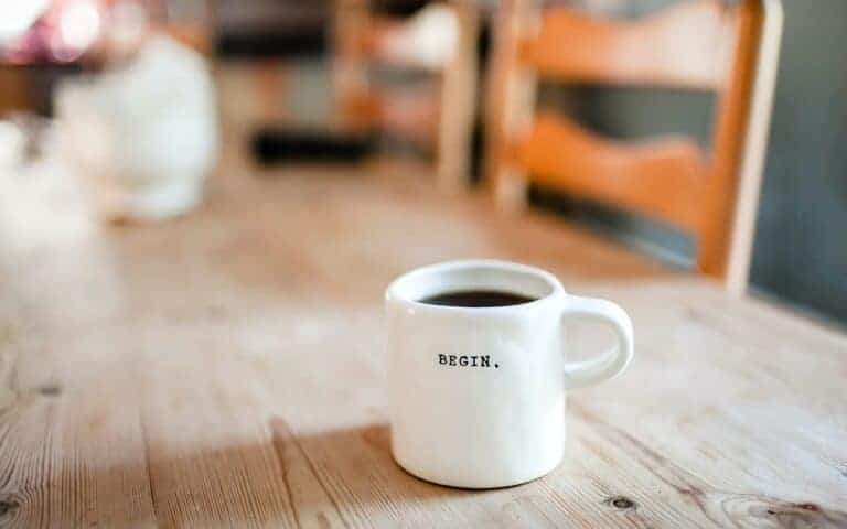 Coffee cup reads 'begin'