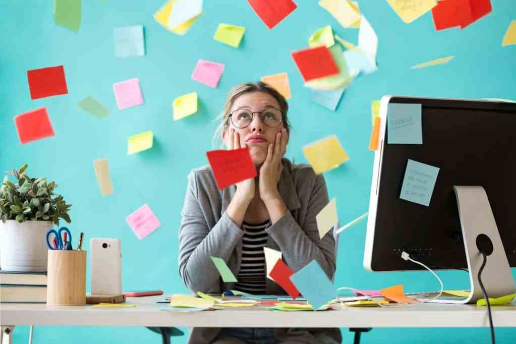 Busy woman surrounded by post-it notes