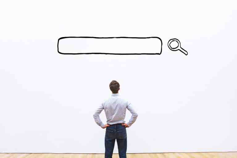 man stands in front of an SEO search box